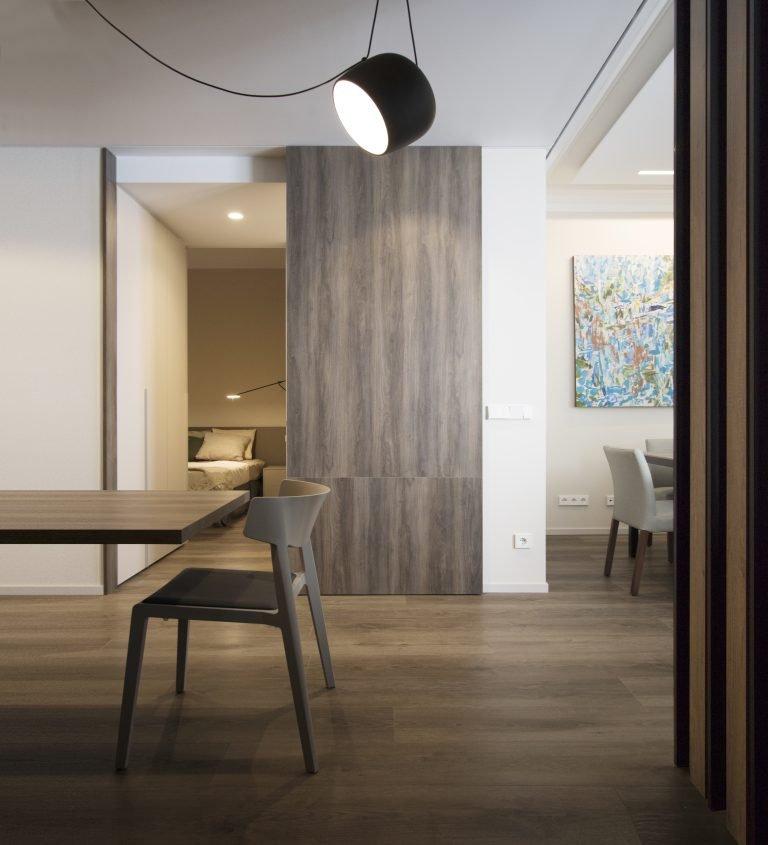 arquitectura interiorismo reforma valencia casa quart salon comedor cocina celosia isla puerta corredera sudesa