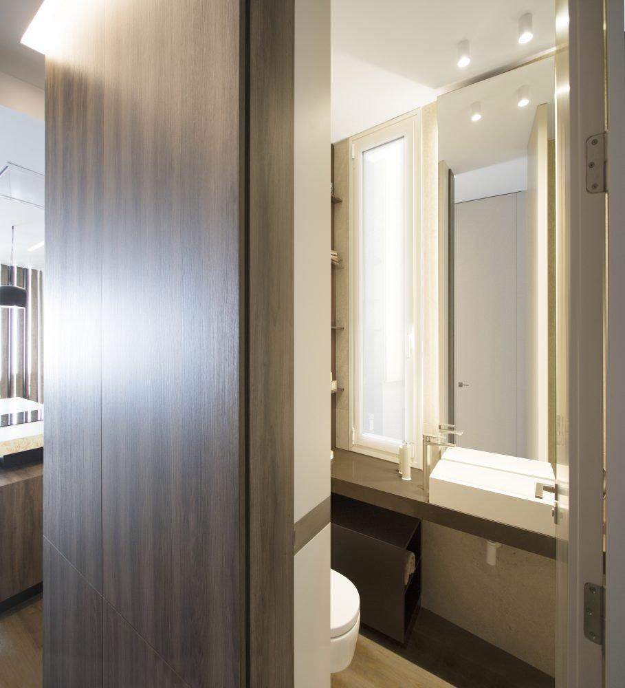 arquitectura-interiorismo-reforma-valencia-casa-quart-baño-armario-vestidor-lavabo-espejo-scaled